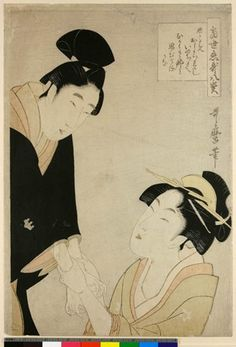 Woodblock print. Oshichi and Kichisaburo. The lovers declaring love, her hands grasping his wrists as he stands over her.