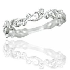 This with a one carrot, simple band, round solitaire! :) vintage wedding rings <3