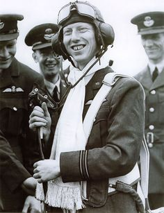 """23-year-old RAF pilot Sergeant James """"Ginger"""" Lacey is awarded a scarf and a parachute (the first parachute made in Australia) for taking down a Heinkel that had bombed Buckingham Palace. Ginger Lacey had a tally of 18 kills while flying a Hurricane during the Battle of Britain (10 July - 31 Oct), the third highest score of the battle's RAF aces. His total score for the war: 28 kills, 5 probables, and 9 damaged."""