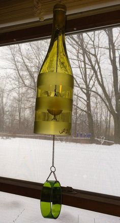 Hand cut and etched wine bottle wind chime.