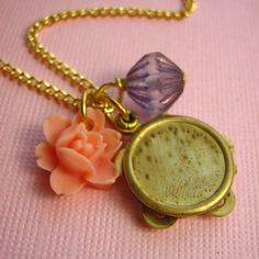 Play A Song For Me Tambourine Necklace.