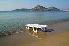 Sunbed in the water on Psili Ammos beach in #Tolo, #Greece