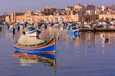 Brightly coloured fishing boats at quaint Marsaxlokk on Malta