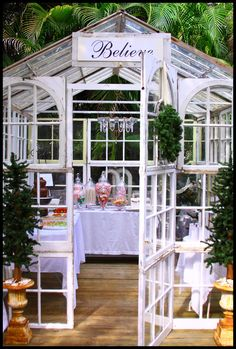 #greenhouse made from re-claimed windows.  A Perfect place for a garden party. Believe.