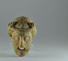 Greek terracotta mask, 4th century B.C. Greek terracotta mask, Greek terracotta theater mask, due the small dimension is a Greek votive theater mask, 6.9 cm long. Private collection