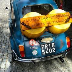Retro Fiat500 & giant piece of parmigiano cheese. Province of Parma Emilia Romagna