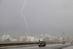 Lightning is seen during a storm over Havana on June 17, 2013.  [Credit : Desmond Boylan/Reuters]