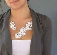for some reason, i can't get asymmetrical  white lace necklaces out of my head.  feel free to like it too, but please don't buy this one; i've got my eye on it.