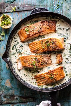 Keeping things super quick and very delicious with this Garlic Butter Creamed Spinach Salmon. This one skillet salmon is for those nights when you're craving something fancy.ish, but need to keep things quick and easy Salmon Recipes, Fish Recipes, Seafood Recipes, Dinner Recipes, Cooking Recipes, Healthy Recipes, Dinner Ideas, Salmon Food, Cooking Food
