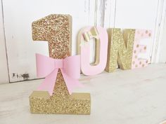 """1st Birthday #1 with PINK BOW ~ Gold Glitter ~ 8"""" Free Standing ~ Photo Prop ~ Decoration ~ Table Decor by WhateversHandmades on Etsy https://www.etsy.com/listing/479890611/1st-birthday-1-with-pink-bow-gold"""