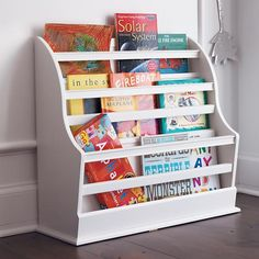 A floor book bin for the teacher/book play area. Keeps books within reach, and visible for the little ones.