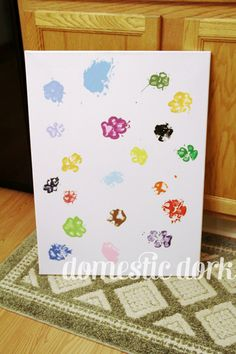 Paw print canvas for dog lovers!  My sister has done one paw print with each dog she's fostered.