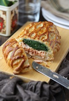 Salmon en Croûte - crisp and buttery puff pastry enveloping a delicious salmon fillet with béchamel and spinach.