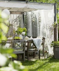 Outdoor dining room. Summer decorating with mosquito nets, garden pergolas and gazebo designs