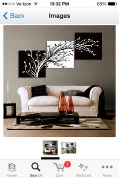 Living room idea; I especially like the series of canvases-so pretty!!