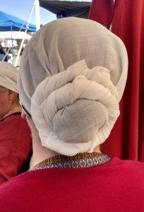 """Back view of the knotted, """"coiled"""" headscarf."""
