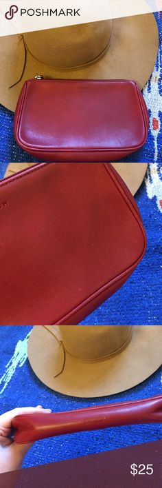 """Coach wallet Coach wallet in red leather. In good condition, has some wear to edges and a few small stains/discoloration. Still in great working condition and inside is clean. Has one pocket inside. It measures about 8.25"""" wide and 4.5"""" tall. Coach Bags Wallets"""
