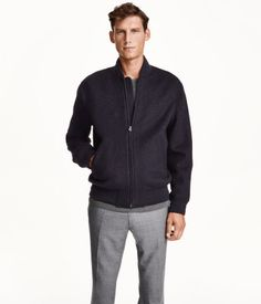 Jacket in a felted wool blend with a ribbed stand-up collar. Zip at front, side pockets with flap and concealed fastener, and ribbing at cuffs and hem. Lined.