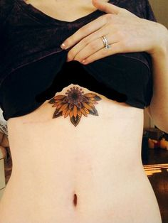 Colored Sunflower Sternum Underboob Flower Tattoo Idea for Women at MyBodiArt.com