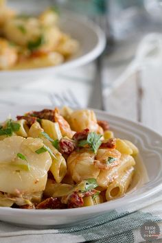 Key West Penne - shrimp, scallops, sun-dried tomatoes and artichoke hearts in a creamy pasta!