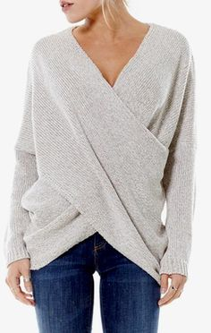 Long Sleeve Drape Front Chunky Knit Sweater Made in the USA This amazing knit sweater is perfect layered over white skinnies or pop it in your tote to throw on when it gets chilly by the bonfire Model is Wearing a Small Sweater is 60% Polyester and 40% Acrylic.    -We also carry a lighter weight version of this best seller in grey and black!