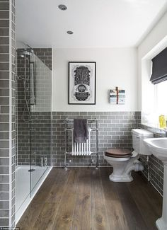grey bathroom with subway tiles and wood effect flooring. Vintage industrial style bathroom