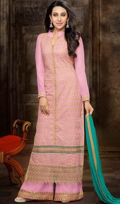 Look more than enchanting and adorable similar like Karisma Kapoor dressed up in this pink embroidered georgette palazzo suit. The attractive lace and resham work throughout the attire is awe-inspiring. #DullishPinkAnkleLengthPalazzoSuit