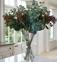 Our artificial Eucalyptus sprays look stunning mixed with the fake red berries of the Hypericum. A beautiful artificial winter display.
