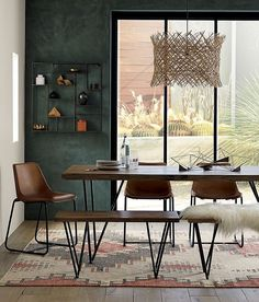 Dining rooms don't have to be formal or stuffy. We're all about a boho chic dining space, too! Check out these 40 dining rooms that master boho interior design. For more dining room design ideas, go to Domino! Table Design, Dining Room Design, Modern Dining Table, Dining Chairs, Dining Rooms, Carpet In Dining Room, Rooms Ideas, Boho Chic Living Room, Chairs