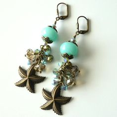 You will love these new beachy earrings with the fabulous aqua lampwork beads, gorgeous sparkling crystals and antique brass starfish charm! The crystals are all hand wire wrapped for security. These pretties measure 2 3/4 from the top of the antique brass leverback earwire and they are one of a kind! Perfect for a beach wedding or anytime!  Thank you to my sister Sheila for the beautiful lampwork beads...you had to know these were going by way of the beach…