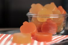Homemade Fruit and Veggie Gummy Snacks- •1 1/2 cups of juice total (Fresh carrot, apple, orange juice for orange and •fresh lemon, apple, pineapple juice for yellow), •1/4 cup grass-fed gelatin, •3 tablespoons raw honey, •Pumpkin gummy molds OR just a pyrex and cut into squares