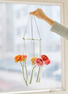 Turn some test tubes into a chandelier for flowers.