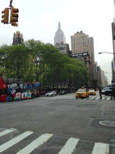 (c)beautflstranger May 2015 Bryant park, Empire State Building, yellow Cab, Tour Bus.   6th Avenue.