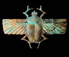 Open for flight!  This Egyptian Scarab is a realistic rendition of the real thing.  He's is a brass stamping made in the USA. He has a green verdigris patina that I have aged myself.  He measures 45mm tall and has a wing span of 70mm.  This uniquely finished piece can be purchased at filigreeandme.com