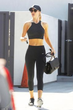 Flashing the abs: News of the British stunner's success comes as she was spotted heading out of her local exercise emporium in West Hollywood on Tuesday - looking simply sensational in the process