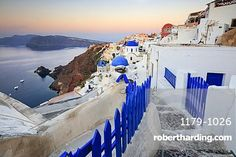 The last light of dusk over the Aegean Sea seen from the typical village of Oia…