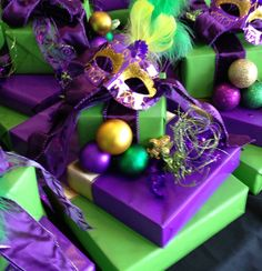Mardi Gras Centerpiece - wrapped boxes; use peacock feathers instead of masks.