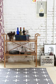Could make a cute plant stand instead of bar.  4040 Locust Rustic Metal Console at Urban Outfitters