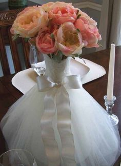 shower centerpiece idea - tulle cinched around a bouquet to resemble a wedding gown  *link no longer available