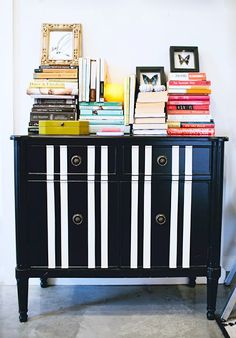 lauren lagarde's colorful book arrangement and bold diy dresser, via the everygirl.