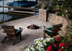 Picturesque Outdoor Lake Side Relax Area Be Equipped Small Round Wood Burner Firepit Between Rustic Two Dark Varnished Barn Wood Chairs On Slates Tile Floor In Front Curved Stony Raised Garden Stands As Well As Lp Fire Pit Also Backyard Fire Pits of Affordable And Easy Rustic Outdoor Fire Pit Ideas from Exterior Ideas