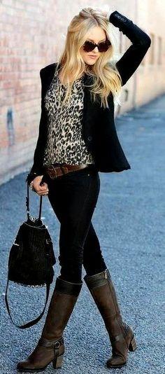Casual outfit: black blazer, black sunglasees, black shoulder bag, brown belt, printed top, black pants and knee high boots.
