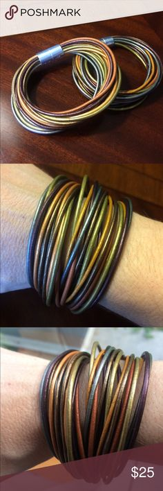"""Set of two metallic leather cord bracelets Metallic leather cord bracelets bound by a magnetic closure. Great colors to go with a variety of outfits-various options. Never worn, like new. Measures 7"""". Jewelry Bracelets"""