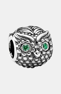 Free shipping and returns on PANDORA 'Wise Owl' Charm at Nordstrom.com. Gleaming green eyes peep from beneath the swooping brow of a carved sterling-silver owl. The shiny charm symbolizes insightful, wise, protective and mystic qualities and, thus, makes a meaningful gift.