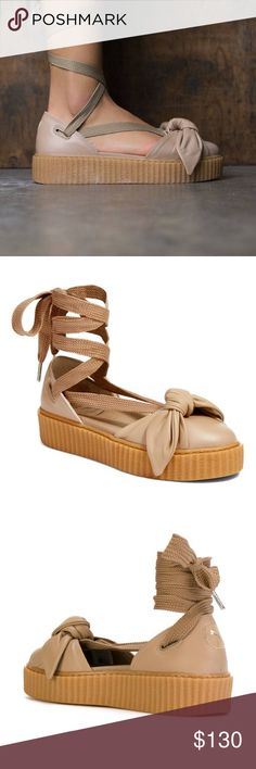 Puma Fenty Bow creeper lace up sandal Brand new in excellent condition! These are a very unique style and they're awesome looking when worn! Small platform type shoe with lace up strings and a cute bow on the toe. Puma Shoes Platforms