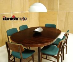 Mid Century Danish Modern Rosewood Round / Oval Dining Table. I want this table...!
