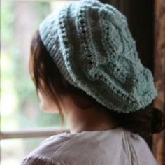 Stella Hat A soft, slouchy beret with a simple lace pattern and whimsical top knit in DK to light worsted weight yarn, worked from the bottom up the hat can be more or less slouchy to suit individual tastes. Sized to fit a woman's medium.  This is a free downloadable pattern.
