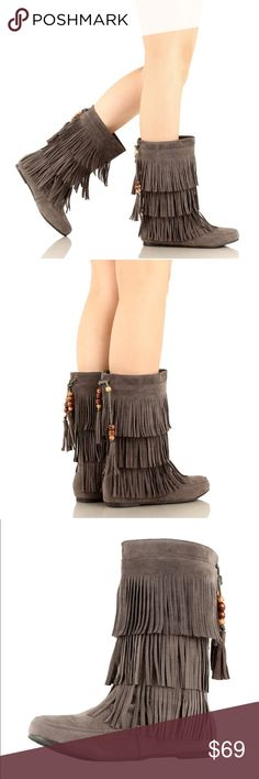 Three Layers Grey Fringe Moccasin Boots Add a little shake and fun to your outfits in these three-tier fringe moccasin boots. These pull-on boots feature faux suede uppers that offers a breathable and flexible fit and feel to them. Along with a moc toe design and a beaded tassel at the back of the boot's shaft, these boho booties are comfortable and adds an earthy look to your outfits!  Shaft measures approximately 10.5 from arch Vegan Suede Upper. Boutique Shoes Winter & Rain Boots