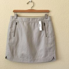 JCrew canvas skirt with shirttail hem NWT! This is a reposh! I love it but was hoping it was white when I bought it! But it's more of an oatmeal color. So cute on, tags still attached! I love the zippers and hem line! J. Crew Skirts Mini