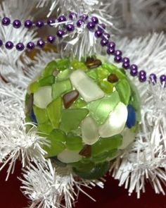 12 Homemade Coastal Xmas Ornaments to Make This seaglass Xmas ornament is my favorite from last year's Coastal Living's Editors Ornament Contest. The challenge was to take one plain, glass ball ornament and make it shine. Sea Glass Crafts, Seashell Crafts, Beach Crafts, Driftwood Crafts, Beach Ornaments, Glass Christmas Ornaments, Christmas Balls, Nautical Christmas, Beach Christmas
